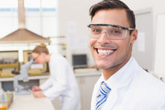 Happy scientist smiling at camera. In the laboratory Royalty Free Stock Image