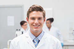 Happy scientist smiling at camera. In the laboratory Royalty Free Stock Images