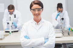 Happy scientist smiling at camera with protective glasses. In the laboratory Royalty Free Stock Photos