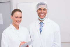Happy scientist team smiling at camera. In the laboratory Stock Photography