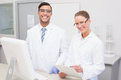 Happy scientists smiling at camera. In the laboratory Royalty Free Stock Photo