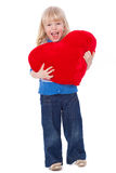 Happy screaming child with red heart Stock Images