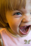 Happy Screaming Girl. A very close-up shot to show emotion of a happy screaming one year old girl who is almost age two Royalty Free Stock Image