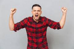 Happy screaming man looking at camera Stock Images