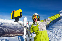 Happy screaming skier take photo with camera Stock Image