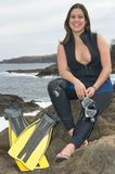 Happy scuba diver woman near the sea. With pins Royalty Free Stock Photography