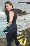 Happy scuba diver woman near the sea Stock Images