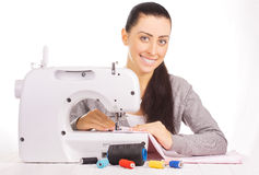 Happy seamstress sewing. isolated on the white Stock Images