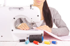 Happy seamstress sewing. isolated on the white Royalty Free Stock Photo