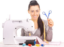 Happy seamstress sewing. isolated on the white Stock Photos