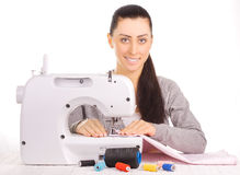 Happy seamstress sewing. isolated on the white Stock Photography