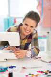 Happy seamstress sewing in studio Royalty Free Stock Photo