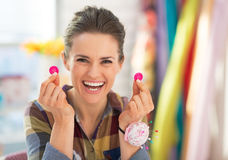 Happy seamstress showing buttons Royalty Free Stock Photography