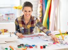 Happy seamstress working in studio Stock Photo