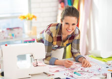 Happy seamstress working in studio Royalty Free Stock Image