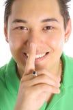 Happy secret asian man Stock Photo