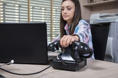 A happy secretary answers the caller. Woman in the  office situation Stock Image