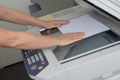 Happy secretary using  photocopy machine in  office. Happy secretary using  photocopy machine in a office Royalty Free Stock Photos