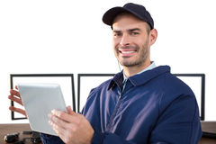 Happy security officer using digital tablet at desk Stock Photos