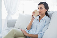 Happy seductive brunette drinking coffee Royalty Free Stock Photo