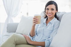 Happy seductive brunette having coffee Royalty Free Stock Image