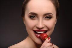 Happy seductive girl eating strawberry Royalty Free Stock Photo