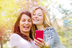 Happy self portrait. Two happy girls making a self portrait Royalty Free Stock Photography