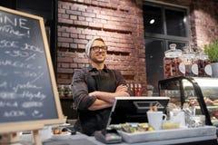 Happy seller man or barman at cafe counter Stock Image