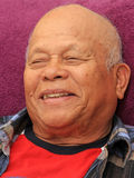 Happy Senior. Face shot of a charming, happy, senior Filipino man, laughing Stock Photo