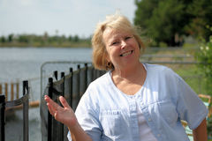 Happy Senior. Photo of a happy senior by the waterfront Stock Photos