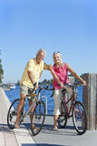 Happy Senior Active Couple on Bicycles Royalty Free Stock Photography