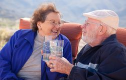 Happy Senior Adult Couple with Drinks Stock Photos