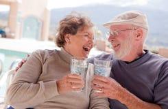Happy Senior Adult Couple With Drinks Stock Photos