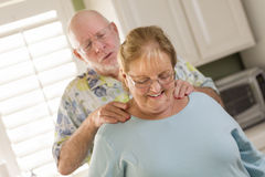 Senior Adult Husband Giving Wife a Shoulder Rub Stock Images