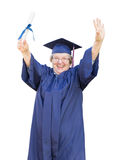 Happy Senior Adult Woman Graduate In Cap and Gown Holding Diplom Royalty Free Stock Photos