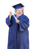 Happy Senior Adult Woman Graduate In Cap and Gown Holding Diplom Royalty Free Stock Photography