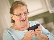 Senior Adult Woman Texting on Smart Cell Phone Royalty Free Stock Image