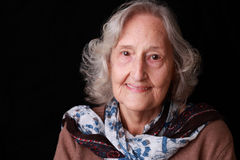 Happy Senior Adult Woman. Very happy senior woman in her 80's smiling and looking directly into the camera Stock Photos