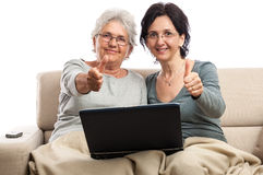 Happy senior and adult women at laptop thumb up Royalty Free Stock Photo