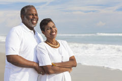 Happy Senior African American Couple on Beach. Happy romantic senior African American men and women couple on a deserted tropical beach Royalty Free Stock Photos
