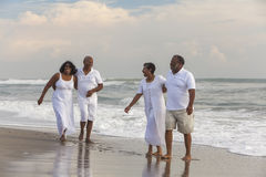 Happy Senior African American Couples Men Women on Beach Stock Photography