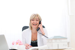 Happy senior architect woman having good news Stock Photo