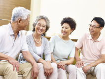 Happy senior asian couples chatting at home Royalty Free Stock Image