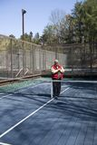 Happy senior athlete  platform tennis paddle court. Happy senior athlete on platform tennis paddle court Royalty Free Stock Photography