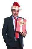 Happy senior business man holding a big present box Stock Images