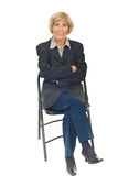 Happy senior business woman on chair royalty free stock images
