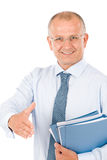 Happy senior businessman handshake close deal. Happy successful businessman giving handshake close deal isolated portrait Royalty Free Stock Photography