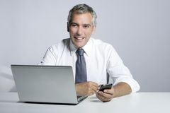 Happy senior businessman laptop mobile portrait Royalty Free Stock Photo