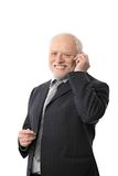 Happy senior businessman on the phone. Portrait of happy senior businessman talking on mobile phone, isolated on white Royalty Free Stock Photo