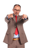 Happy senior businessman pointing fingers Stock Photography